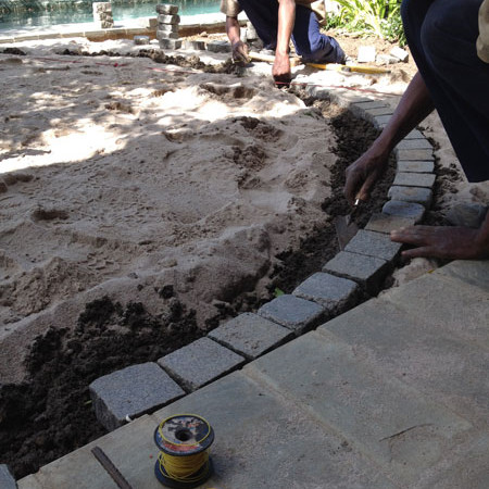 Laying paving for lawn edge