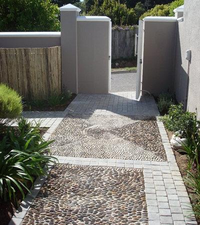 Pebble panels within cobbled borders