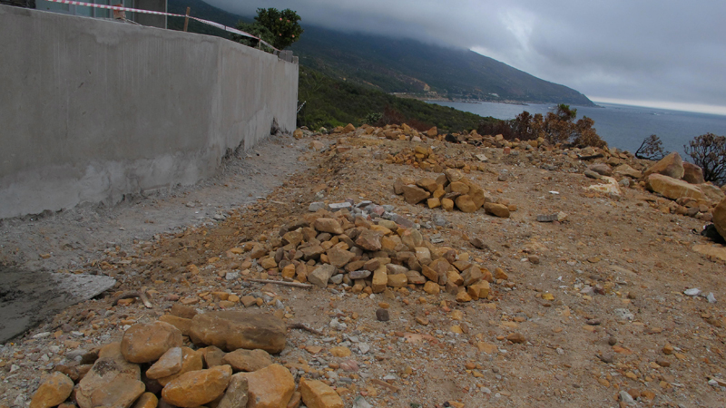 Collecting rock in piles for re-use