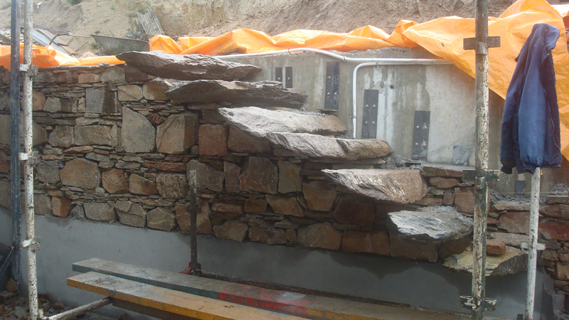 The packing of small stones and cement between the steps is also important to retain structural integrity