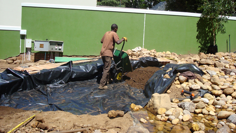 Installing the liner for the river section to enter the pool