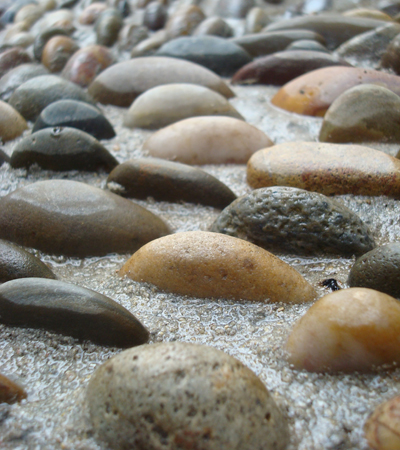 A macro view of the pebbles set in cement