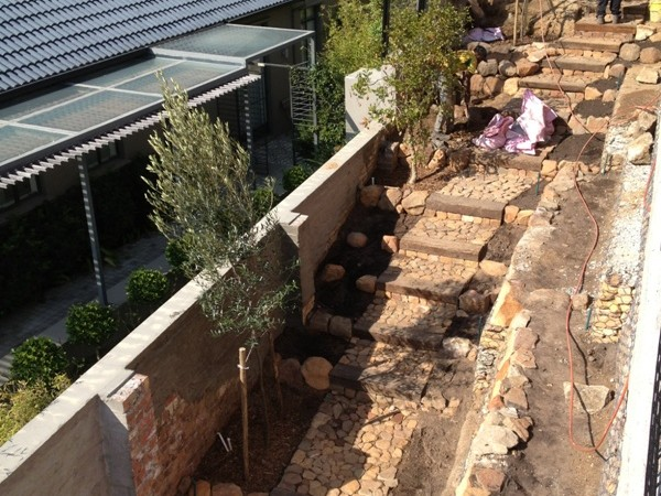 Cobbled natural stone and sleeper path during construction